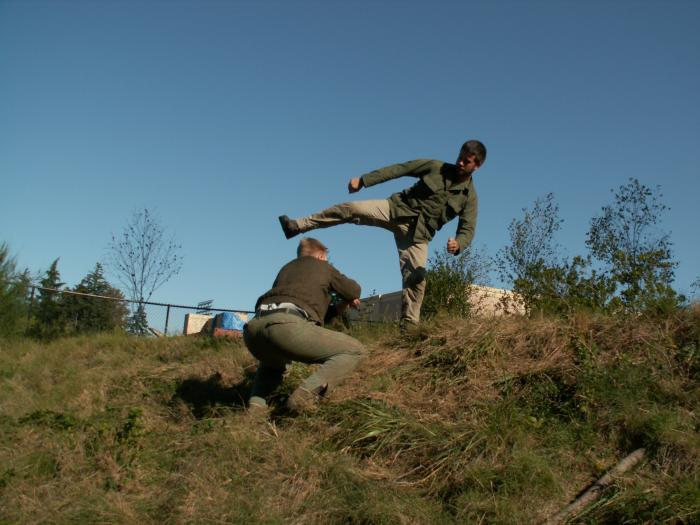 Training outdoors Sat 10 11 08 working on uneven rough ground covered with hidden obstacles and dangers and lessons.