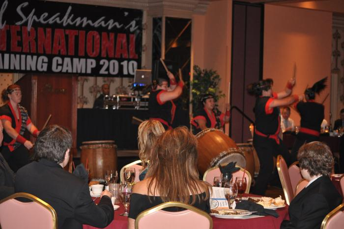 Banquet entertainment of an all-female group on drums.